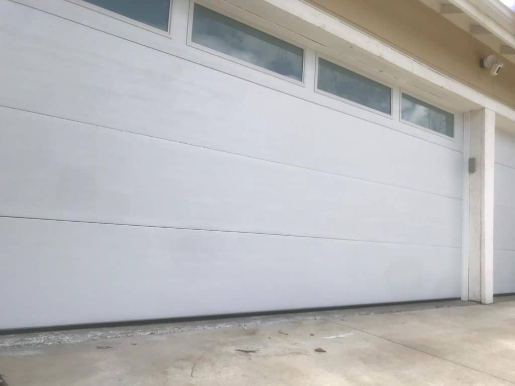 Who Should You Call to Get Your Faulty Garage Door Moving Again?